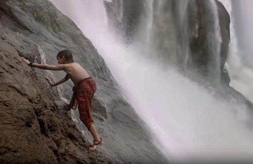 Shivudu climbs waterfall